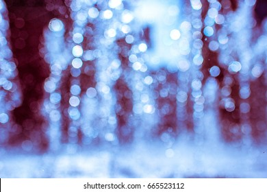 Bokeh, blured. The gush of water of a fountain. Splash of water in the fountain, abstract image.Foam in the sea. The gush of water of a fountain. Splash of water in the fountain, abstract image.