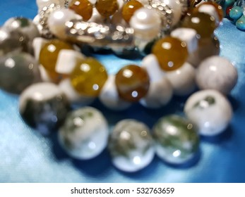 Bokeh of Blurred natural semiprecious stone bracelet used for background