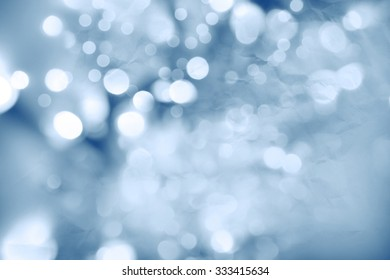 Bokeh circles and paper texture abstract blue background