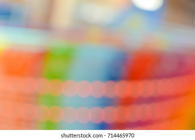Bokeh colorful bright light from electric LED garlands, abstract celebrated event or fair background