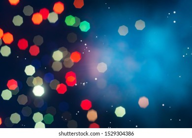 Bokeh of colorful lighting in 7 polygon heptagon in smoky night background with copyspace.Defocused of beautiful  polygon lights and light ray.