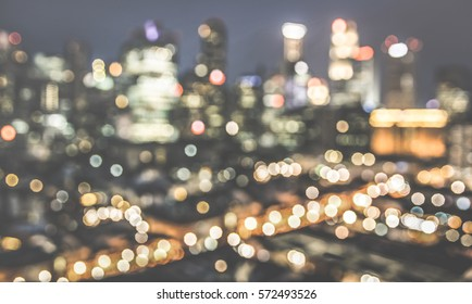 Bokeh filter of Singapore skyline from above during the blue hour - Asian modern city scape with spectacular nightscape panorama - Blurred defocused night lights on retro desaturated contrast filter