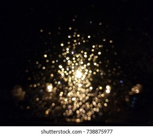 bokeh of golden light shining like glitter of flame with dark black bacground.