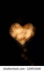 Bokeh heart shaped on black background
