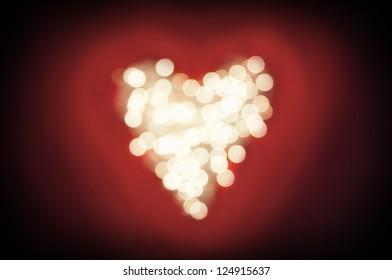Bokeh heart shaped on dark red background