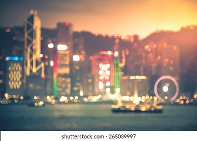 Bokeh light background of Hong Kong Victoria harbor with vintage color tone tuned