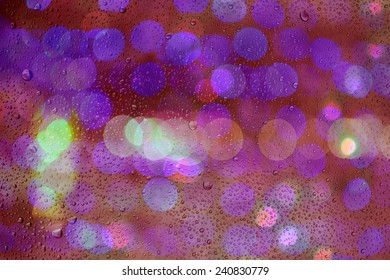 bokeh light background past glass and drop