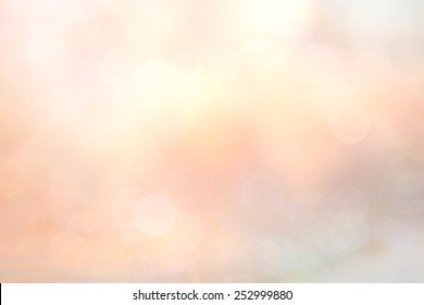 Bokeh light and blur pastel pink color of flower with water sunset beach background