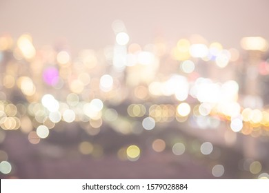 Bokeh  light in the fastival in the evening at Bangkok , Thailand. Abstract bokeh yellow light of the city in night time and soft color.