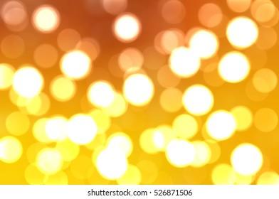 Bokeh light, shimmering blur spot lights on orange.