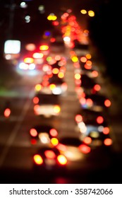 Bokeh, lights, bokeh, lights of cars on the road at night , Blurred Defocused Lights of Heavy Traffic on a Wet Rainy City Road at Night - Commuting at Rush Hour Concept