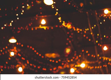 Bokeh lights line background from a night wedding.Blurred of hall wedding.