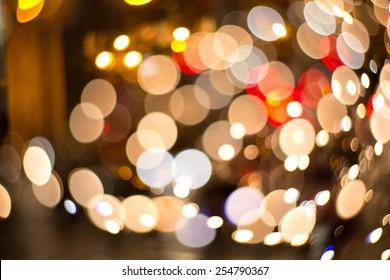 Bokeh lights monster. Beautiful Christmas background.