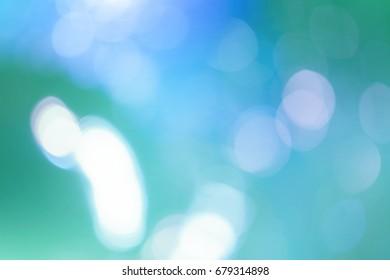 Bokeh lights on fresh mint green background