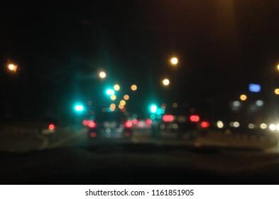 Bokeh lights on road in the city, night lights in city, street lights bokeh background