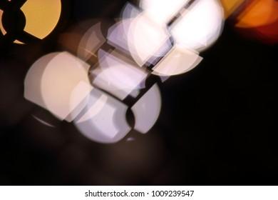 Bokeh Lights Through Chainlink Fence