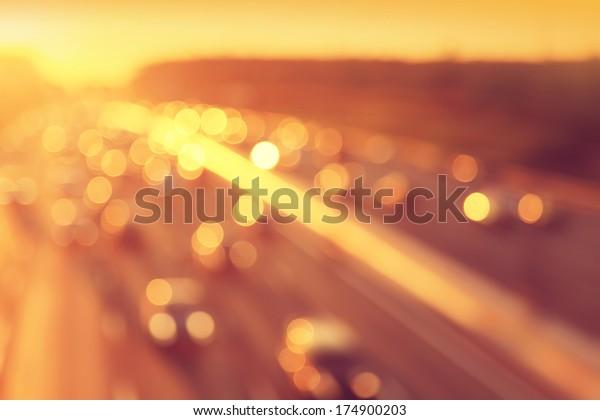 Bokeh lights of traffic during sunset.