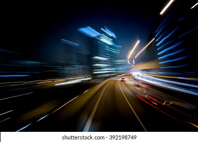 Bokeh motion blur background of miving through Hong Kong street at night