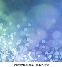 Bokeh on grungy blue background with blueprint
