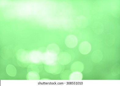 Bokeh on light green blur background, out of focus