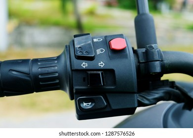 A bokeh photo of honk, signal and lamp push button of high speed cruise motorbike.