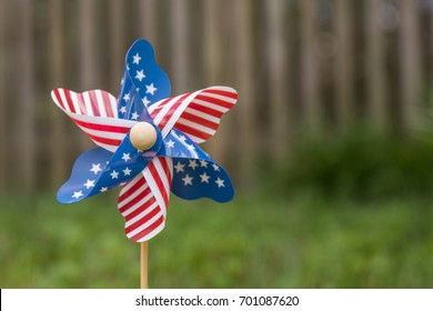 Bokeh photo of a pinwheel with American flag stars and stripes