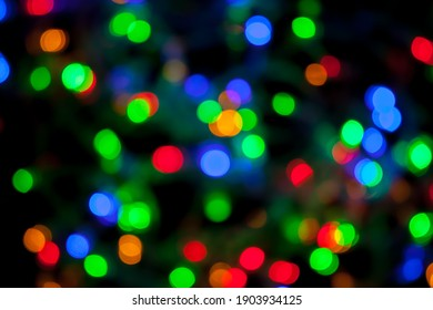 bokeh texture of multicolored christmas and new year lights