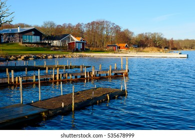 Bokenas, Sweden - December 12, 2016: Documentary of coastal lifestyle. Seaside houses with private piers one fine winter morning.