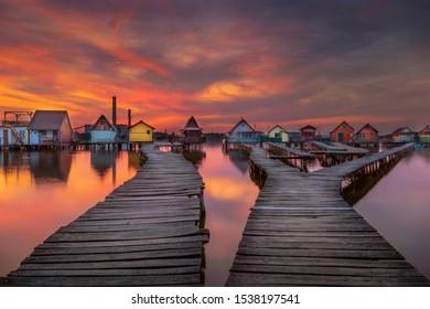 bokod lake, floating village at sunset