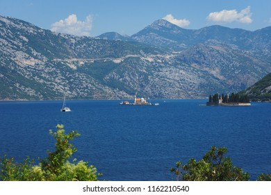 Boko-kotorska bay in Montenegro. Epic view of the island of Saint George Island and the Roman Catholic Church of Our Lady of the Rocks Church. Landscape, a trip to Montenegro, Perast and Kotor.