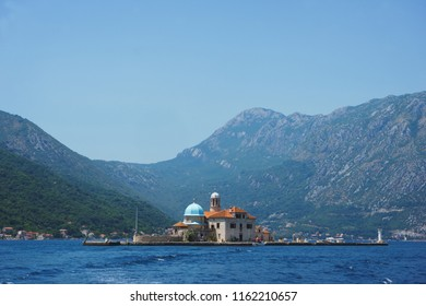 Boko-kotorska bay in Montenegro. View of the island of Saint George Island and the Roman Catholic Church of Our Lady of the Rocks Church. Landscape, a trip to Montenegro, Perast and Kotor.