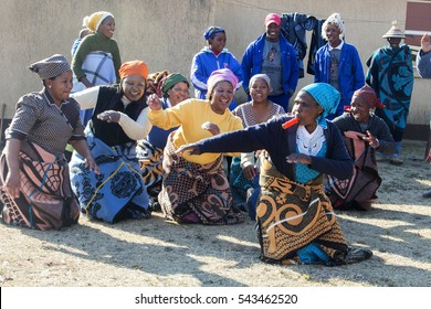 Bokong, Lesotho  - 15 July, 2016. African women Bantu nation Basotho tribe in modern handmade traditional colorful blankets are dancing in the village. Tribal ritual before the Lesotho King birthday .