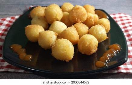 Bola-bola kentang keju or pom pom kentang  or mashed potatoes cheese balls in black plate on wooden table