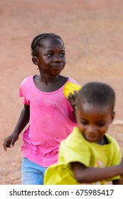 BOLAMA ISLAND, GUINEA BISSAU - MAY 6, 2017: Unidentified local children run along the street in the ghost town of Bolama, the former capital of Portuguese Guinea