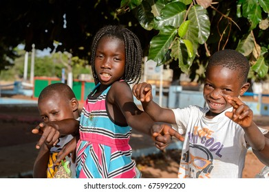 BOLAMA ISLAND, GUINEA BISSAU - MAY 6, 2017: Unidentified local children play in the yard in the ghost town of Bolama, the former capital of Portuguese Guinea
