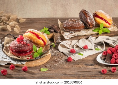 """Bolas de Berlim, or """"Berlin Balls"""". Portuguese fried dough with sugar, Filled with chocolate or raspberry jam. Portuguese fried dough with sugar."""