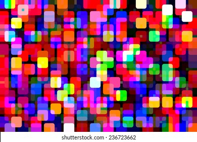 Bold abstract of holiday lights of various colors overlapping on a black background