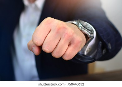 Bold businessman making a fist hit . Concept of determination and punch.