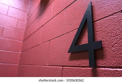 Bold number 4 on a pink cinder block wall