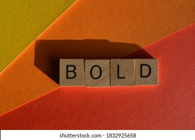 Bold, word in wooden alphabet letters isolated on brightly coloured background