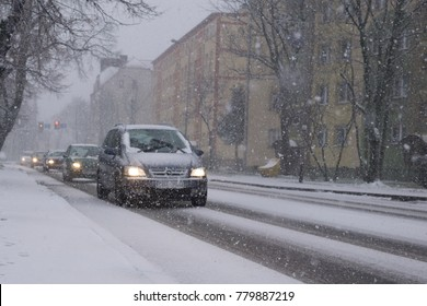 Boleslawiec, Poland December 2017, unidentified cars go in the heavy snow through the street in Boleslawiec, Poland in December 2017