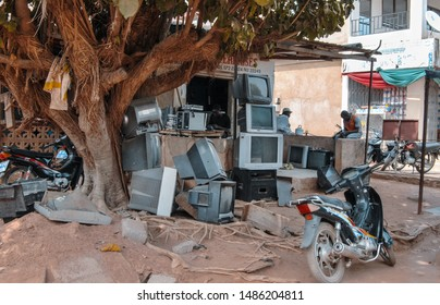 Bolga / Ghana - 03.14.2015: A pile of old tvs (television sets) in front of a ghanaian tv repair shop in Bolgatanga, Ghana, West Africa