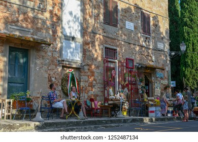 Bolgheri, Livorno / Italy - June 21 2018: Street view of the medieval village of Bolgheri in the Maremma area with tourists in front of a typical products shop, Tuscany