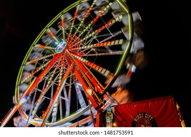 Bolingbrook, IL - August 16, 2019: Residents enjoy the ferris wheel at Bolingbrook's Jubilee. Motion blur of the ferris wheel on first night of the 3-day event.
