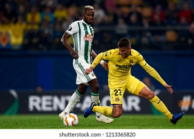 Bolingoli of Rap Wien and Raba of Villarreal competes for the ball during the match of the Europa League between Villarreal CF and Rapid Wien at La Ceramica Stadium Villarreal, Spain on October 2018