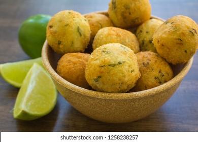 bolinhos de bacalhau - codfish in Portuguese - delicious salty Brazilian cuisine on the table.