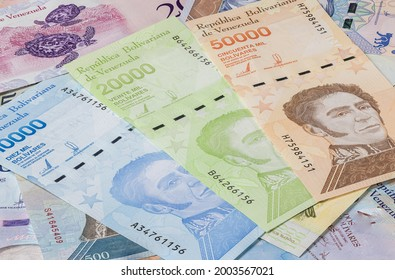 Bolivares or Bolivar money of the republic Venezuela. Close up to the currency of the south American country Venezuela. High inflation and weak economy increases the denomination of the banknotes.
