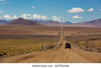 Bolivia, Andes region with an offroad car driving through the waste land  offroad