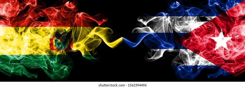 Bolivia, Bolivian vs Cuba, Cuban smoky mystic states flags placed side by side. Concept and idea thick colored silky abstract smoke flags