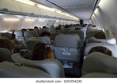 BOLIVIA, LA PAZ, 19 FEBRUARY 2017 - Economy class airplane cabin interior with passengers of Bolivian Airlines